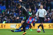 Wilfried Zaha of Crystal Palace and Marco van Ginkel of Stoke City compete for the ball during The Emirates FA Cup fourth round match between Crystal Palace and Stoke City at Selhurst Park on January 30, 2016 in London, England.