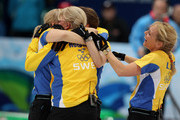 (L-R) Anette Norberg, Eva Lund, Cathrine Lindahl and Anna Le Moine celebrate after victory over Canada in the women's gold medal curling game between Canada and Sweden on day 15 of the Vancouver 2010 Winter Olympics at Vancouver Olympic Centre on February 26, 2010 in Vancouver, Canada.