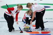 Eve Muirhead of Great Britain and Northern Ireland releases the stone as teammates Kelly Wood (L) and Lorna Vevers brush the ice during the Women's Curling Round Robin match between Great Britain and China on day 6 of the Vancouver 2010 Winter Olympics at the Vancouver Olympic Centre on February 17, 2010 in Vancouver, Canada.