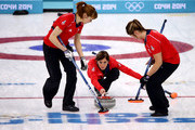 Eve Muirhead of Great Britain (C) plays a stone as Claire Hamilton (L) and Vicki Adams (R) assist during the Bronze medal match between Switzerland and Great Britain on day 13 of the Sochi 2014 Winter Olympics at Ice Cube Curling Center on February 20, 2014 in Sochi, Russia.