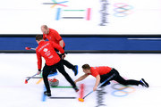 Kyle Waddell of Great Britain throws a rock as Thomas Muirhead and Cameron Smith follow to sweep in a 6-5 win over Japan during the Men's Curling Round Robin on day 6 of the PyeongChang 2018 Winter Olympics at Gangneung Curling Centre on February 15, 2018 in Gangneung, South Korea.