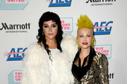 Kesha (L) and Cyndi Lauper arrive at the Cyndi Lauper And Friends: Home For The Holidays Benefit at The Novo by Microsoft on December 10, 2019 in Los Angeles, California.