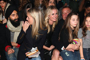 (L-R) Waris Ahluwalia, Meredith Melling Burke Rebecca Romijn and Hunter Hill attend the Cynthia Rowley fall 2012 fashion show during Mercedes-Benz Fashion Week at the IAC Building on February 9, 2012 in New York City.