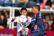 Andy Najar #14 of DC United and Sherjill MacDonald #7 of Chicago Fire fight for the ball at Toyota Park on October 27, 2012 in Bridgeview, Illinois.