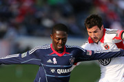 Patrick Nyarko #14 of Chicago Fire and Chris Pontius #13 of DC United fight for the ball at Toyota Park on October 27, 2012 in Bridgeview, Illinois.
