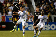 Sean Franklin #5 of D.C. United heads the ball above Landon Donovan #10 of the Los Angeles Galaxy as Gyasi Zardes #11 looks on during the first half at StubHub Center on August 27, 2014 in Los Angeles, California.