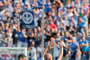 Marco Di Vaio #9 of the Montreal Impact celebrates a goal with teammate Jeb Brovsky #15 and salues the crowd during the MLS match at Saputo Stadium on August 25, 2012 in Montreal, Quebec, Canada.