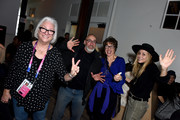 """(L-R) Teri Schwartz, Dean of the UCLA School of Theatre, Film and Television (UCLA TFT), Robert Jones, and Maria Bello at the """"Blinded by the Light"""" afterparty at DIRECTV Lodge presented by AT&T at Sundance Film Festival 2019 on January 27, 2019 in Park City, Utah."""