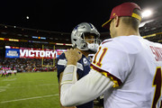 Quarterback Dak Prescott #4 of the Dallas Cowboys and quarterback Alex Smith #11 of the Washington Redskins talk after the Redskins defeated the Cowboys 20-17 at FedExField on October 21, 2018 in Landover, Maryland.