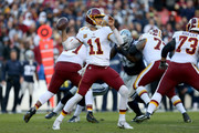 Alex Smith #11 of the Washington Redskins passes the ball against the Dallas Cowboys during the first half at FedExField on October 21, 2018 in Landover, Maryland.