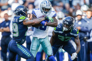 Wide Receiver Michael Gallup #13 of the Dallas Cowboys catches a pass as Safety Earl Thomas #29 of the Seattle Seahawks defends during the second half at CenturyLink Field on September 23, 2018 in Seattle, Washington.