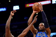 Harrison Barnes #40 of the Dallas Mavericks shoots a jumper over Luol Deng #9 of the Los Angeles Lakers during the first half at Staples Center on December 29, 2016 in Los Angeles, California.  NOTE TO USER: User expressly acknowledges and agrees that, by downloading and or using this photograph, User is consenting to the terms and conditions of the Getty Images License Agreement.