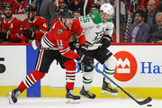 Cody Franson #11 of the Chicago Blackhawks and Brett Ritchie #25 of the Dallas Stars battle for the puck at the United Center on November 30, 2017 in Chicago, Illinois.