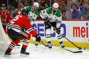 Jamie Benn #14 of the Dallas Stars looks to pass under pressure from Duncan Keith #2 of the Chicago Blackhawks at the United Center on February 8 2018 in Chicago, Illinois.