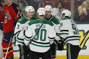 Jamie Benn #14 is congratulated by John Klingberg #3, Jason Spezza #90, and Tyler Seguin #91 of the Dallas Stars after scoring a third period goal to tie the game against the Florida Panthers at the BB&T Center on October 17, 2015 in Sunrise, Florida. The Stars defeated the Panthers 4-2.