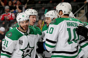 Martin Hanzal #10 of the Dallas Stars is congratulated by teammates Tyler Seguin #91,Esa Lindell #23,Devin Shore #17 and Jamie Benn #14 after he scored a goal in the first period against the New Jersey Devils on December 15, 2017 at Prudential Center in Newark, New Jersey.