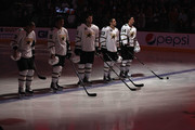 The Dallas Stars stand attended on the ice for the National Anthem before the NHL game against the Phoenix Coyotes at Jobing.com Arena on March 29, 2011 in Glendale, Arizona.  The Coyotes defeated the Stars 2-1 in an overtime shoot out.