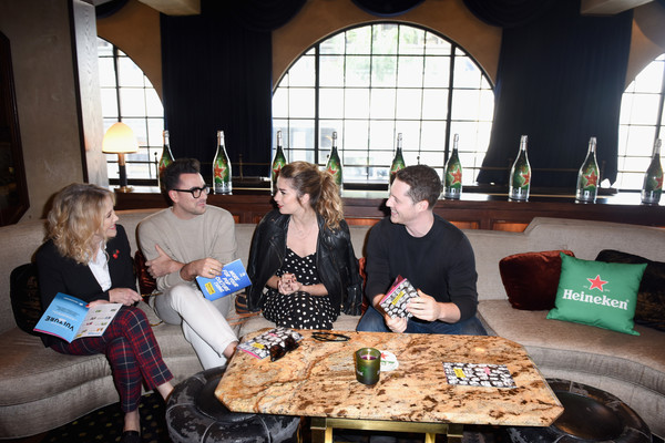 Vulture Festival Presented by AT&T - Heineken Green Room - DAY 1 [table,food,brunch,event,party,lunch,room,meal,cuisine,recreation,annie murphy,noah reid,catherine ohara,l-r,green room,heineken green room,hollywood roosevelt hotel,at t,heineken,vulture festival]