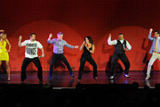 """(L-R) Dancer Kym Johnson, entertainer Joey Fatone, television personality and """"Dancing with the Stars"""" host Tom Bergeron, dancer Lacey Schwimmer, actor Kyle Massey and dancer Tony Dovolani perform during the grand opening of """"Dancing With the Stars: Live in Las Vegas"""" at the New Tropicana Las Vegas April 13, 2012 in Las Vegas, Nevada."""