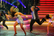 """Dancer Lacey Schwimmer (2nd L) and actor Kyle Massey (3rd L) perform with troupe dancers during the grand opening of """"Dancing With the Stars: Live in Las Vegas"""" at the New Tropicana Las Vegas April 13, 2012 in Las Vegas, Nevada."""