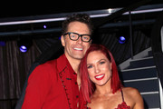 "Bobby Bones (L) and Sharna Burgess pose at ""Dancing with the Stars"" Season 27 at CBS Televison City on September 24, 2018 in Los Angeles, California."