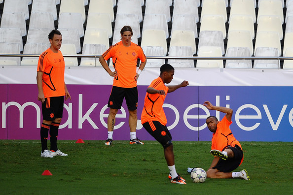 Daniel Sturridge Jose Bosingwa of Chelsea tackles team mate Daniel Sturridge as John Terry (L) and Fernando Torres look on during a training session ahead of the UEFA Champions League Group E match between Valencia CF and Chelsea at the Estadio Mestalla on September 27, 2011 in Valencia, Spain.