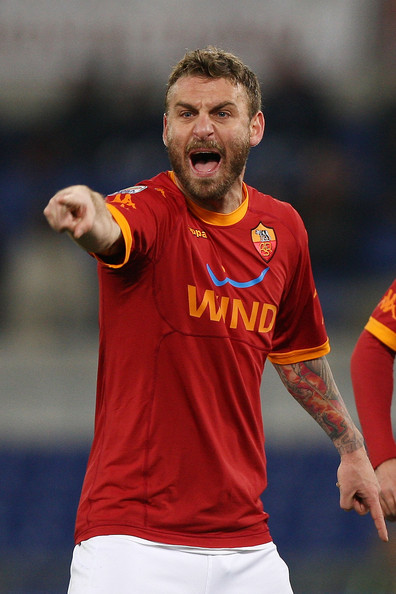 Daniele De Rossi Daniele De Rossi of AS Roma reacts during the Serie A match between AS Roma and Brescia Calcio at Stadio Olimpico on February 2, 2011 in Rome, Italy.
