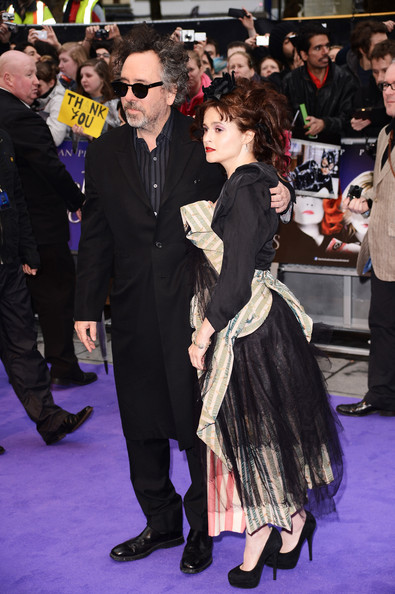 """Filmmaker Tim Burton (L) and actress Helena Bonham Carter attend the European premiere of """"Dark Shadows"""" at Empire Leicester Square on May 9, 2012 in London, England."""