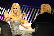 Michelle Hunziker waves at the audience during the 'Das Supertalent' Finals on December 16, 2012 in Cologne, Germany.