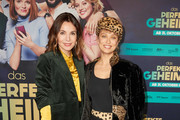 """(L-R) Nadine Warmuth and Caro Cult attend the premiere of """"Das perfekte Geheimnis"""" on October 28, 2019 in Berlin, Germany."""