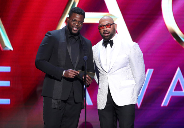51st NAACP Image Awards - Show [event,award,suit,award ceremony,performance,magenta,carpet,formal wear,speech,talent show,dave bautista,l-r,pasadena civic auditorium,california,winston duke,bet,show,naacp image awards,winston duke,dave bautista,51st naacp image awards,tuxedo m.,livingly media,naacp,award,artist]