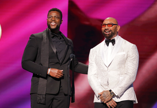 BET Presents The 51st NAACP Image Awards - Show [suit,event,pink,fashion,formal wear,performance,tuxedo,dave bautista,l-r,pasadena civic auditorium,california,winston duke,bet,bet presents the 51st naacp image awards,show,public relations,motivational speaker,tuxedo m.,tuxedo,socialite,musician,motivation,orator,public,artist]