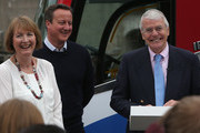 """British Prime Minister David Cameron (2nd L) stands with Labour MP Harriet Harman (L) as former Conservative Prime Minister Sir John Major addresses pro-EU """"Vote Remain"""" supporters during a rally on June 22, 2016 in Bristol, United Kingdom. The final day of campaigning continues across the UK as the country prepares to go to the polls on June 23rd to decide whether Britain should remain or leave the European Union."""