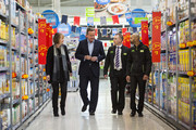 British Prime Minister David Cameron (2nd L) and Former Deputy Labour Leader Harriet Harman (L) speak to Asda employees as they visit an Asda supermarket in Hayes on May 22, 2016 in London, England. Mr Cameron and politicians from different political parties are campaigning to remain in the European Union ahead of the EU referendum on June 23.
