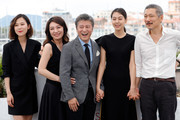 """Actors Kim Saebyuk, Cho Yunhee, Haehyo Kwon, Kim Min Hee and director Hong SangSoo attend """"The Day After (Geu Hu)"""" photocall during the 70th annual Cannes Film Festival at Palais des Festivals on May 22, 2017 in Cannes, France."""