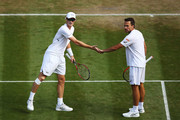 Jamie Murray of Great Britain and Bruno Soares of Brazil celebrate a point against Raven Klaasen of South Africa and Michael Venus of New Zealand during their Men's Doubles Quarter-Finals match on day eight of the Wimbledon Lawn Tennis Championships at All England Lawn Tennis and Croquet Club on July 10, 2018 in London, England.