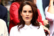 Actress Michelle Dockery attends day eight of the Wimbledon Lawn Tennis Championships at All England Lawn Tennis and Croquet Club on July 10, 2018 in London, England.
