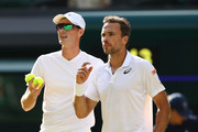 Jamie Murray of Great Britain and Bruno Soares of Brazil talk tactics against Raven Klaasen of South Africa and Michael Venus of New Zealand during their Men's Doubles Quarter-Finals match on day eight of the Wimbledon Lawn Tennis Championships at All England Lawn Tennis and Croquet Club on July 10, 2018 in London, England.