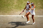 Timea Babos of Hungary, and playing partner Kristina Mladenovic of France react in their Ladies' Doubles semi-final match against Su-Wei Hsieh of Taiwan and Barbora Strycova of The Czech Republic during Day eleven of The Championships - Wimbledon 2019 at All England Lawn Tennis and Croquet Club on July 12, 2019 in London, England.