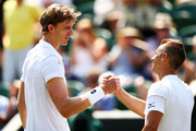 Kevin Anderson of South Africa shakes hands with Philipp Kohlschreiber of Germany after their Men's Singles third round match on day five of the Wimbledon Lawn Tennis Championships at All England Lawn Tennis and Croquet Club on July 6, 2018 in London, England.