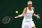 Sabine Lisicki of Germany plays a forehand during the Ladies Singles second round match agaist Samantha Stosur of Australia on day four of the Wimbledon Lawn Tennis Championships at the All England Lawn Tennis and Croquet Club on June 30, 2016 in London, England.