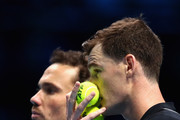 Jamie Murray of Great Britain and partner Bruno Soares of Brazil speak during the doubles match against Ivan Dodig of Croatia and Marcel Granollers of Spain on day four of the 2017 Nitto ATP World Tour Finals at O2 Arena on November 15, 2017 in London, England.