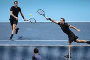 Jamie Murray of Great Britain and partner Bruno Soares of Brazil return the ball during the doubles match against Ivan Dodig of Croatia and Marcel Granollers of Spainon day four of the 2017 Nitto ATP World Tour Finals at O2 Arena on November 15, 2017 in London, England.
