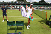 Ana Ivanovic leaves the court following defeat during the Ladies Singles first round match against Ekaterina Alexandrova  on day one of the Wimbledon Lawn Tennis Championships at the All England Lawn Tennis and Croquet Club on June 27th, 2016 in London, England.