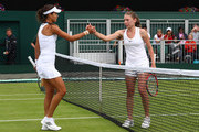 Ekaterina Alexandrova shakes hands with Ana Ivanovic following victory in the Ladies Singles first round match on day one of the Wimbledon Lawn Tennis Championships at the All England Lawn Tennis and Croquet Club on June 27th, 2016 in London, England.