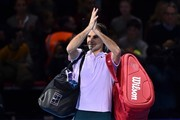 Switzerland's Roger Federer applauds the crowd as he leaves the court after losing to Belgium's David Goffin during their men's singles semi-final match on day seven of the ATP World Tour Finals tennis tournament at the O2 Arena in London on November 18, 2017..David Goffin won 2-6, 6-3, 6-4.  / AFP PHOTO / Glyn KIRK