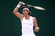 Carla Suarez Navarro of Spain plays a shot in her Ladies' Singles third round match against Lauren Davis of The United States during Day six of The Championships - Wimbledon 2019 at All England Lawn Tennis and Croquet Club on July 06, 2019 in London, England.