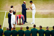 Novak Djokovic of Serbia receives the trophy from Prince Edward, Duke of Kent after winning the Final Of The Gentlemen's Singles against Roger Federer of Switzerland on day thirteen of the Wimbledon Lawn Tennis Championships at the All England Lawn Tennis and Croquet Club on July 12, 2015 in London, England.