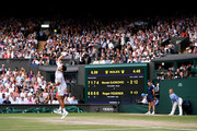 The scoreboard is seen in the final set in the Men's Singles final between Novak Djokovic of Serbia and Roger Federer of Switzerland during Day thirteen of The Championships - Wimbledon 2019 at All England Lawn Tennis and Croquet Club on July 14, 2019 in London, England.