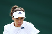 Andrea Petkovic of Germany returns against Yanina Wickmayer of Belgium on day three of the Wimbledon Lawn Tennis Championships at All England Lawn Tennis and Croquet Club on July 4, 2018 in London, England.